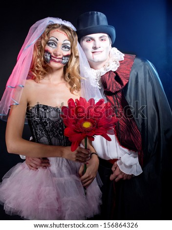man and woman  wearing  as  vampire and witch. Halloween - stock photo