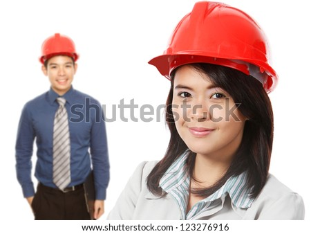 Man and Woman Wearing Hardhats - stock photo