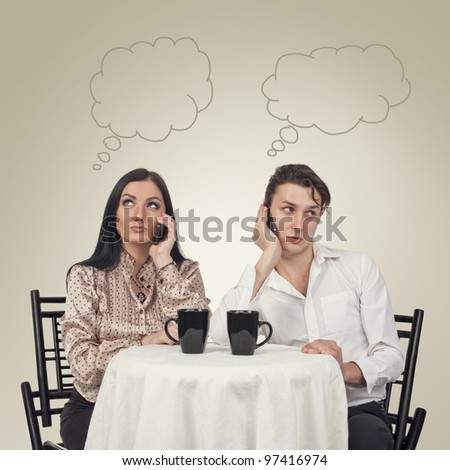 Man and woman with phone