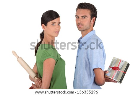 Man and woman with rolling pin