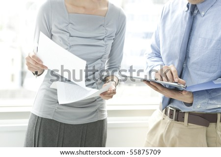 Man and woman with whom it consults - stock photo