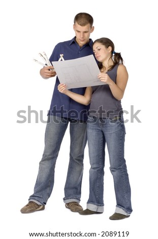 man and woman (workers) standing with measure and house plan - stock photo