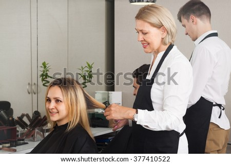 Man and woman working at the barbershop