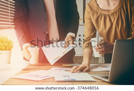 man and woman working in the office. collaborative teamwork. - stock photo