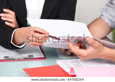 Man and woman working on a document