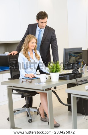 Man and woman working together at the office - stock photo