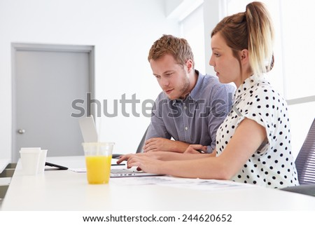 Man And Woman Working Together In Design Studio - stock photo