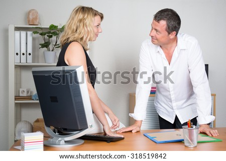 Man and woman working together on a project