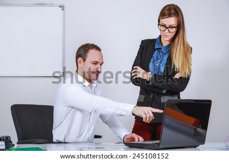Man and woman working with computer - stock photo