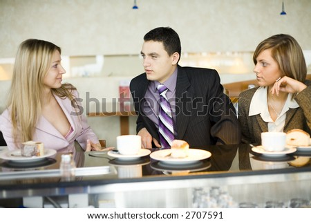 Man and Women at the Bar. Short Depth of Focus (On Man's Face). - stock photo