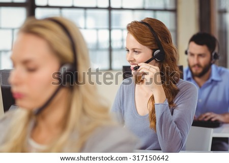 Man and women working in bright office - stock photo