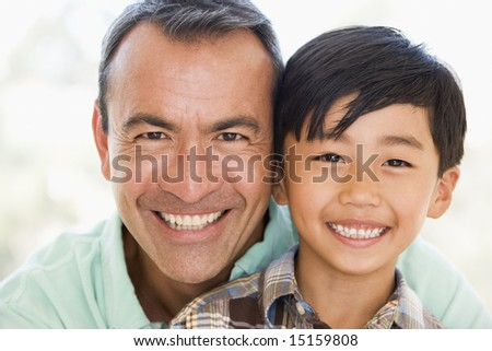 Man and young boy smiling - stock photo