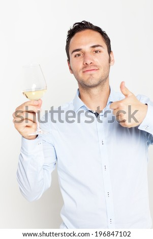 Man approving a glass of white wine