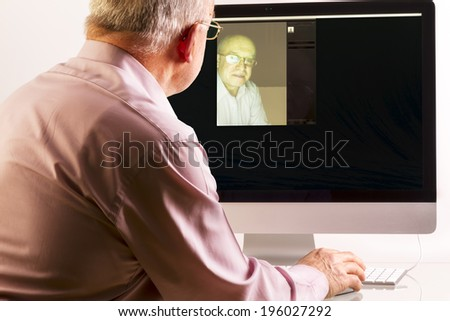 Man at computer on white background