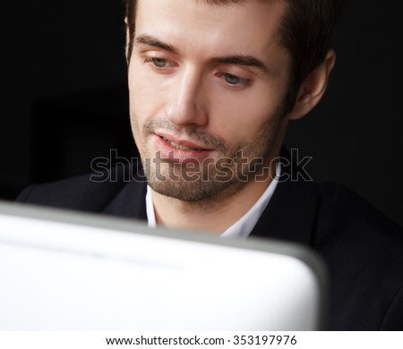man at computer screen - stock photo