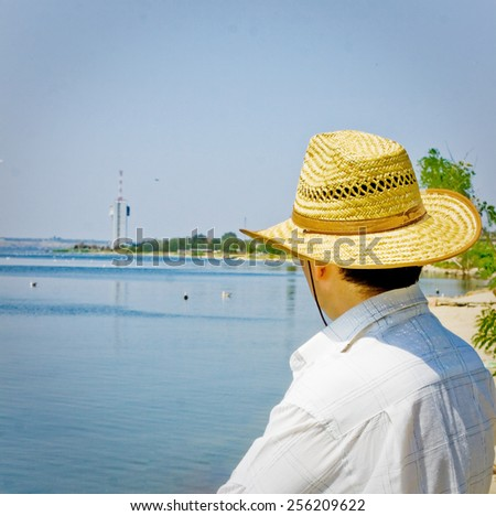 Man at holidays rest at sunny day seaside. - stock photo