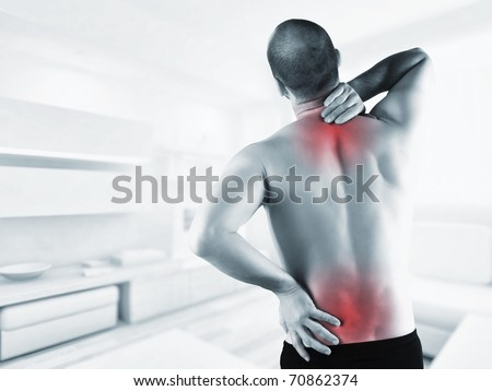 man at home with back pain in red zone - stock photo