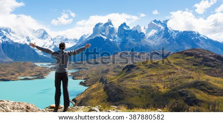 man at mirador condor enjoying hiking and view of cuernos del paine in torres del paine national park, patagonia, chile - stock photo