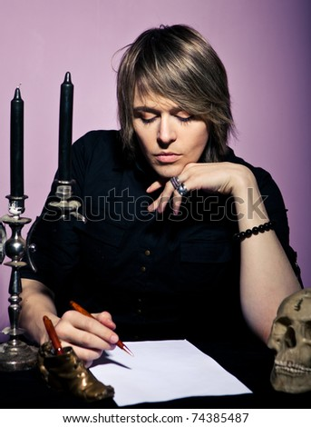 Man at the table wrote a will - stock photo