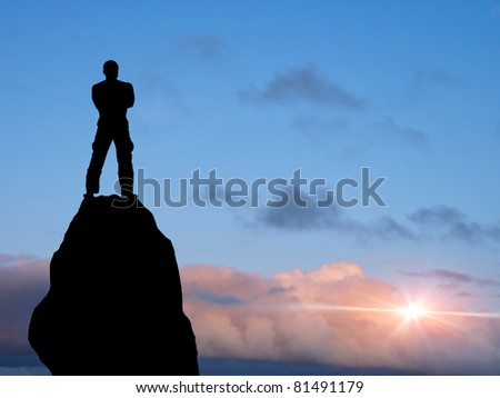 man at the top of the mountain - stock photo