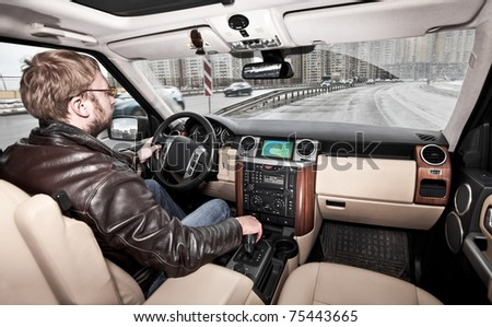 man at the wheel the car - stock photo