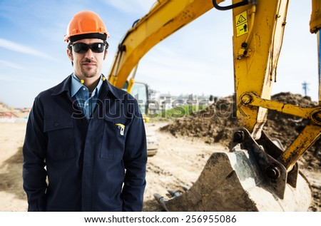 Man at work in a construction site - stock photo