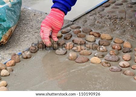 man at work paving stones - stock photo