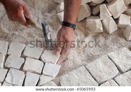 Man at work paving stones