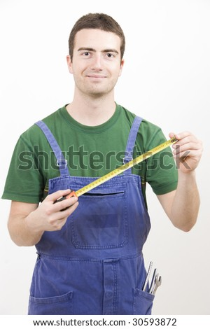 Man at work with a tape measure - stock photo