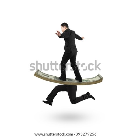 Man balancing on running money with human legs, isolated on white background. - stock photo
