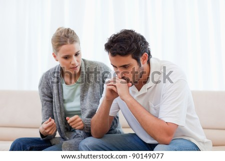 Man being mad at his fiance in their living room - stock photo