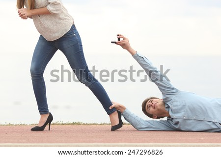 Man being rejected by his girlfriend when is proposing marriage - stock photo
