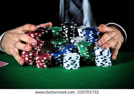 Man betting on the casino - stock photo