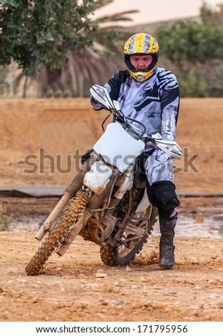 man biker rides through the mud, sport background - stock photo