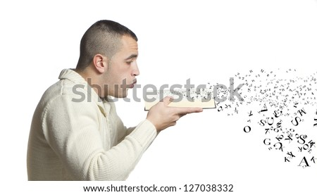 man blowing a book of letters flying off - stock photo