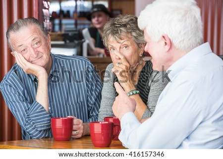 Man boring or annoying couple in coffee house - stock photo