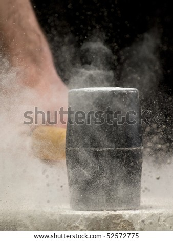 man breaking the stone, may be used as concept for power,strength,destruction,fury,anger,resistance...closeup image with shallow DOF - stock photo