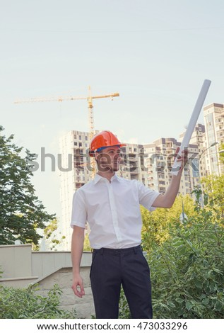 Man builder. Male construction worker holding a construction plan.