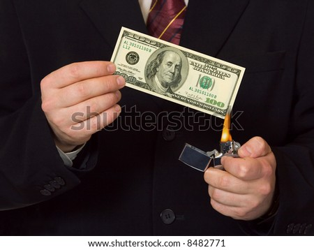 Man burnning the money, business concept - stock photo