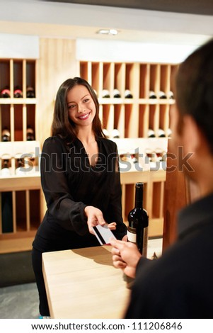 Man buys a wine store - stock photo