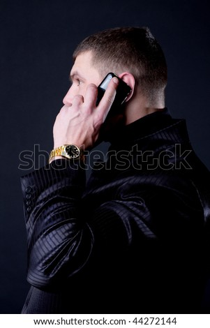 Man calling by phone and wearing gold  watches