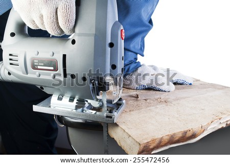 man carpenter builder working with electric jigsaw and wood