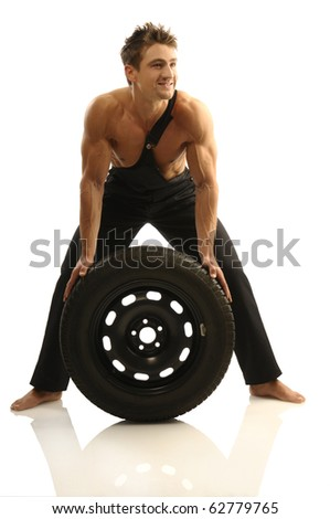 Man carries tires - stock photo