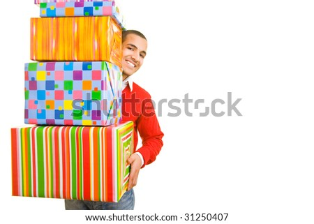 Man carrying a stack of gifts - stock photo
