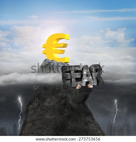 Man carrying 3d fear mottled concrete word, climbing toward golden euro symbol on mountain peak, with opposite weather conditions, sunny sky cloudscape, dark overcast lightning raining cityscape - stock photo