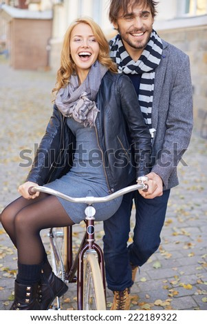 Man carrying his girlfriend on bicycle - stock photo
