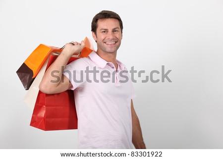 Man carrying shopping bags - stock photo