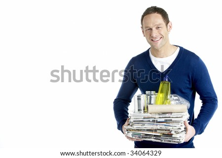 Man Carrying Stack Of Recycling
