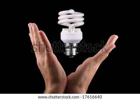 man catching energy efficient lightbulb