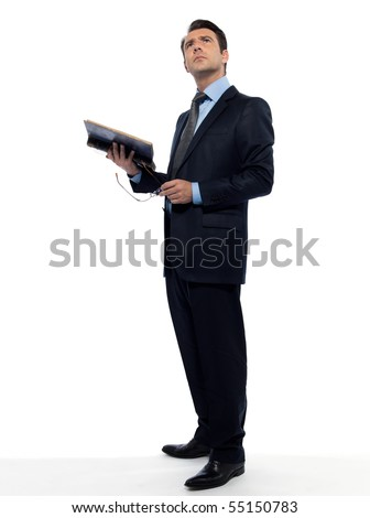 man caucasian professor holding old book looking up isolated studio on white background - stock photo